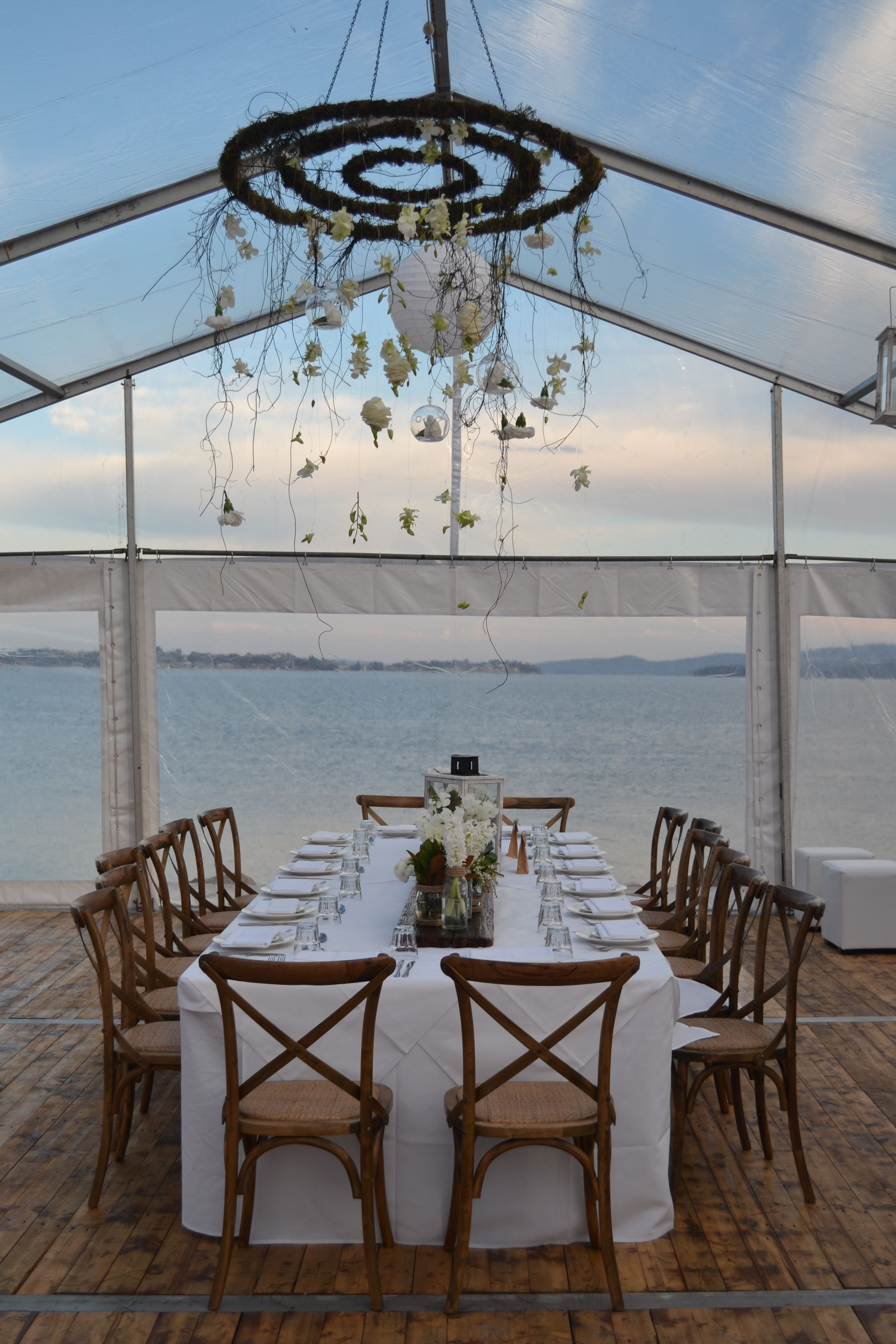 A wedding venue like no other the anchorage port stephens with butlers marquee wedding table centres and unique hanging fresh flower display by pavalyn