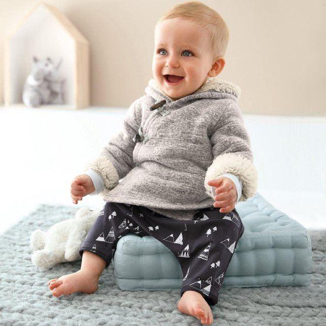 Sarouel en jersey pur coton imprimé. Idéal pour les bébés, il offre une grande liberté de mouvements ! Taille élastiquée.