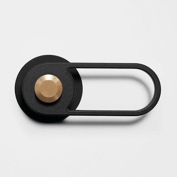 PL-OS No. 01 Pilule Light Door Handle in black powder coated metal and satin brushed brass:
