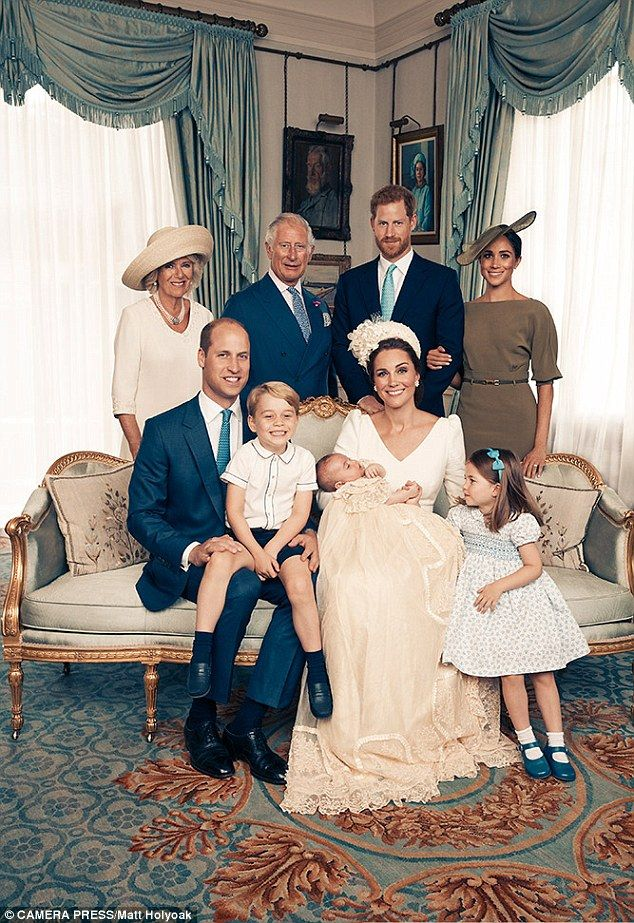 Little Louis beams with delight in new snap from his christening