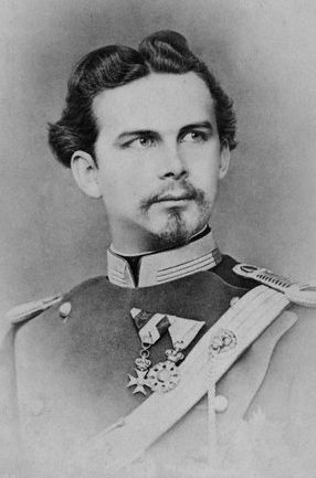 """Ludwig II, King of Bavaria Count Palatine of the Rhine, Duke of Bavaria, Franconia and in Swabia. (1845-1886) He is sometimes called the Swan King, the Fairy tale King and """"Mad King Ludwig"""". He was deposed on grounds of mental incapacity without any medical examination. King Ludwig and the doctor assigned to him in captivity at Castle Berg on Lake Starnberg were both found dead in the lake in waist-high water with unexplained injuries to the head & shoulders, the morning after he was…"""