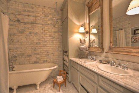 Bathroom- basket weave floor tile, Carrara marble subway tile- restoration hardware mirrors