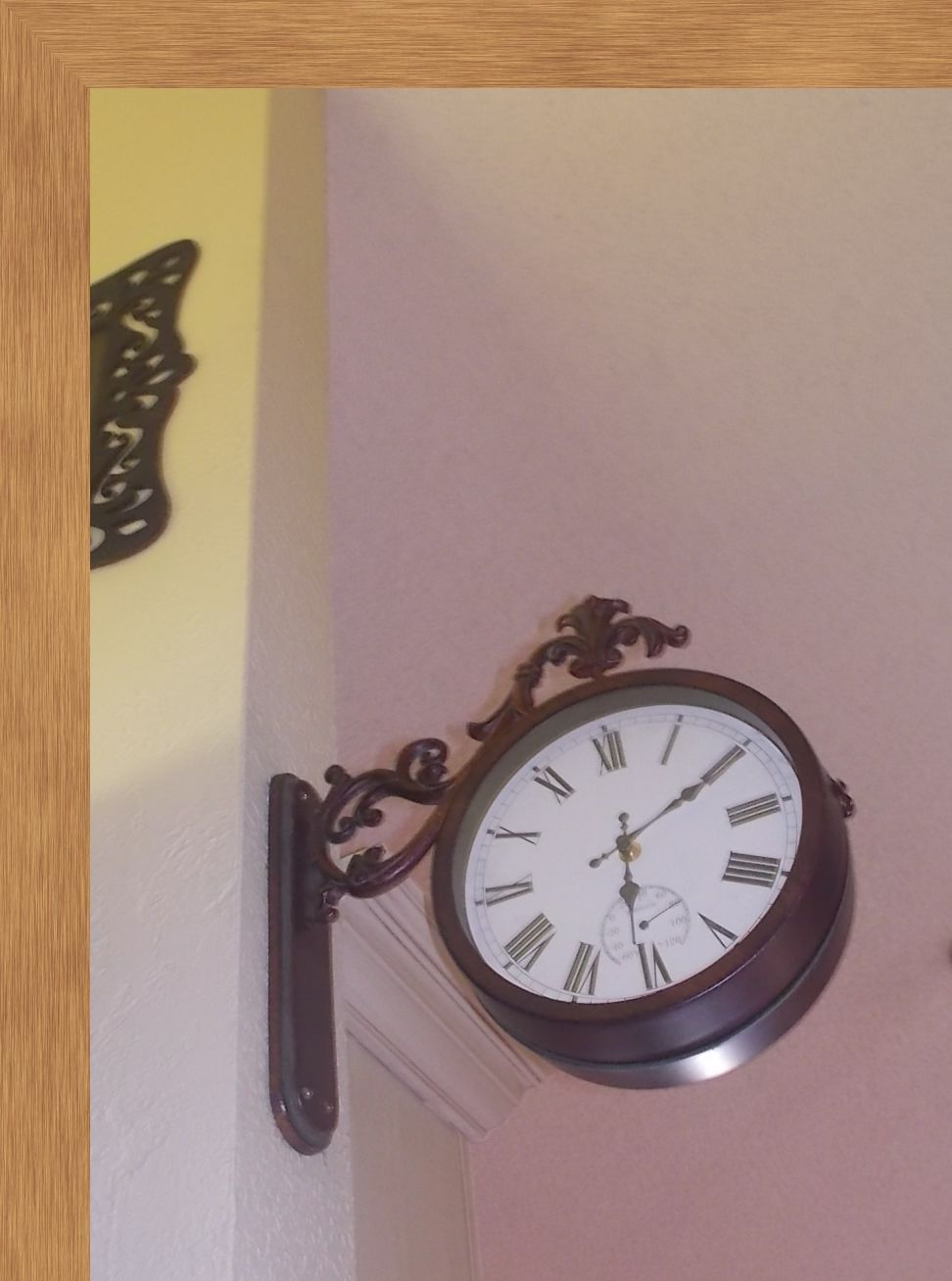 Fleur De Lis clock helps bring in hardware that juts out into the upper space giving authenticity and distracting the narrowness of the space