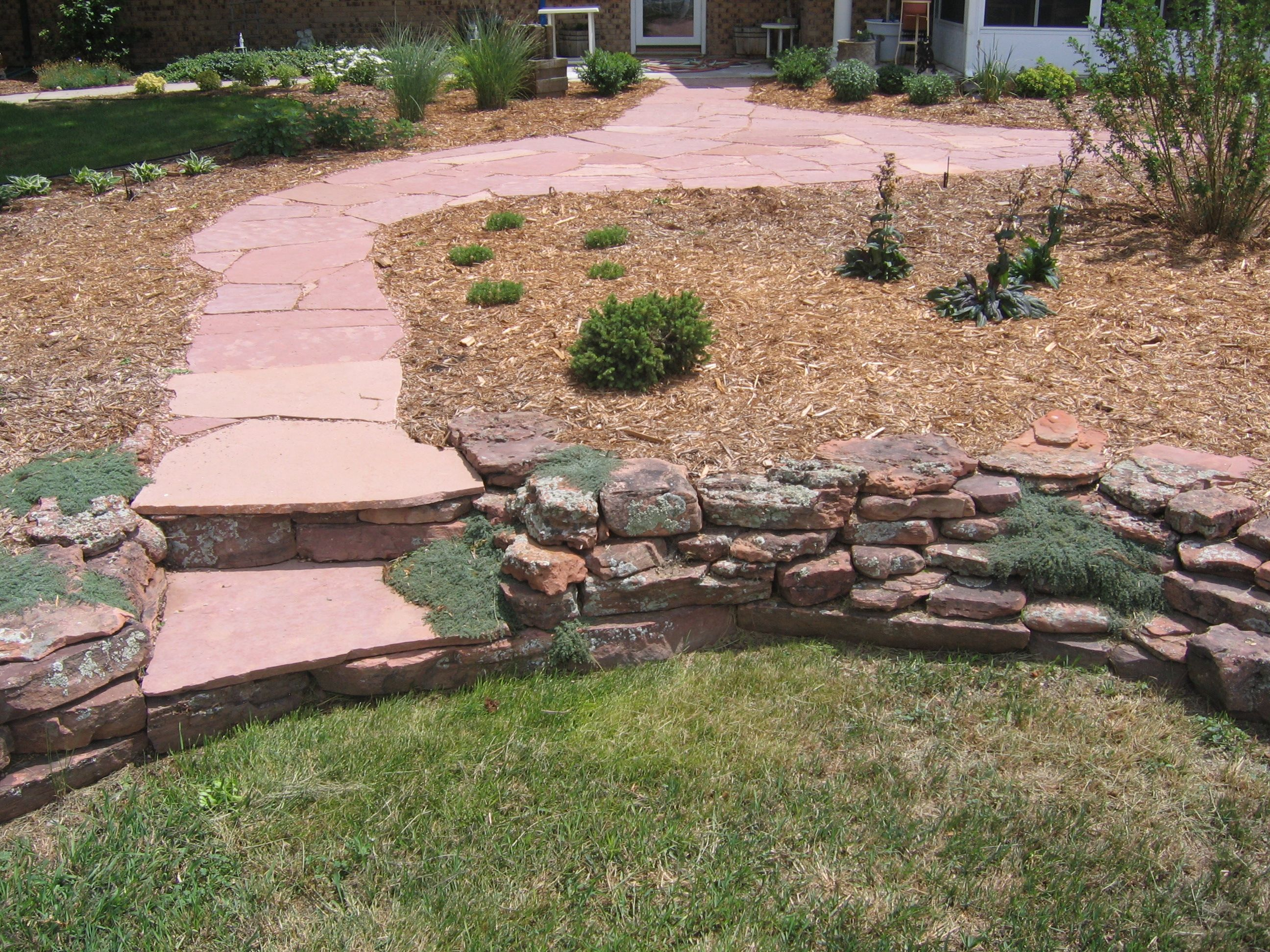 Flagstone Stairs in Moss Rock Wall by Glacier View Landscape & Design, ...