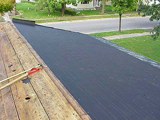 Half of roof with tar paper applied, during re-roofing