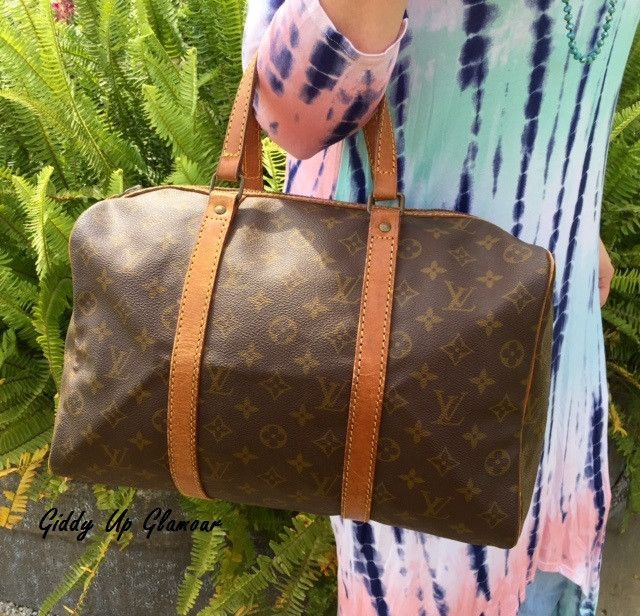 e84c643007d Authentic Used Louis Vuitton Sac Souple 35 Travel Bag in Monogram with Lock