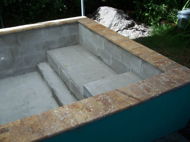 Concrete block pool concrete block puppy pool in for How to build a lap pool