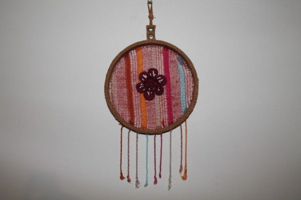 Hipster Wall Hanging Materials Used: belt leather, scarf, felt flower with button. Measures: 20cm diameter COST: $10 https://www.rawroughrecycled.com https://www.facebook.com/RawRoughRecycled