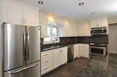 white and gray kitchen with slate, dark countertops