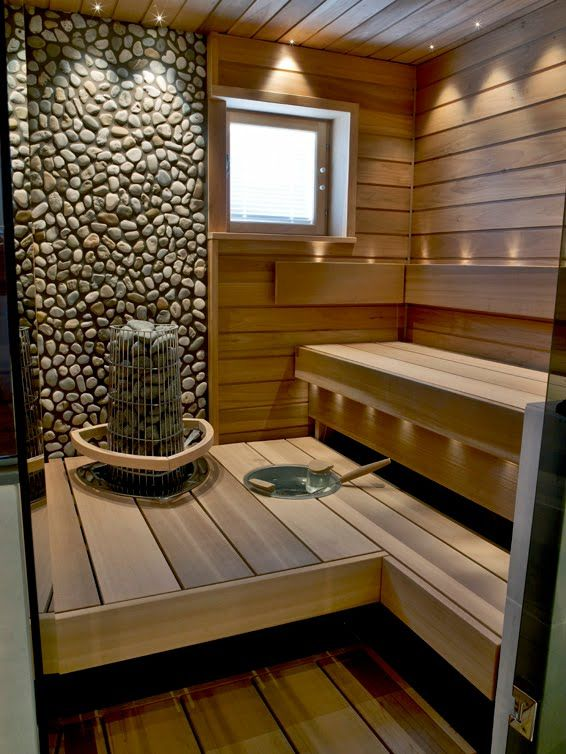 my sauna soon:) Love the River Rock behind the heater for the Sauna...warmth & comfort of wood for the seating and stepping, but the fire-resistant rock as backsplash for the heat.