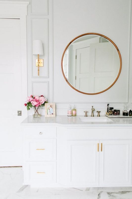 Modern White Bathroom With Gold Hardware And A Round Vanity Mirror,  Designed By House Of Jade, Via