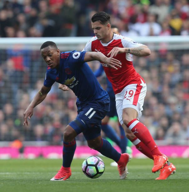 Anthony Martial of Manchester United in action with Granit Xhaka of Arsenal during the Premier League match between Manchester United and Arsenal at...