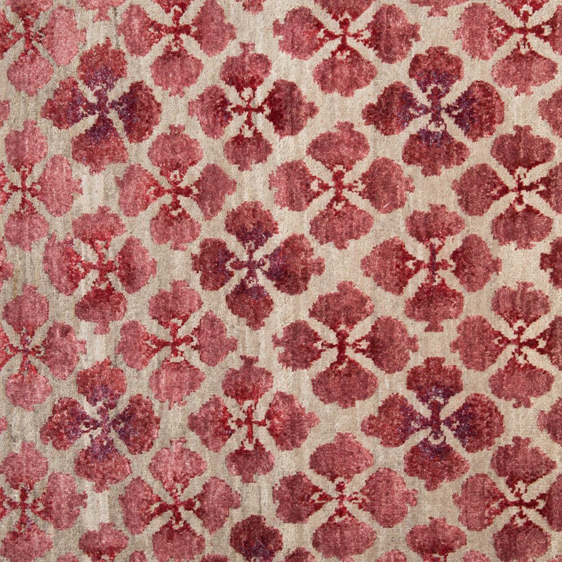'Sakura' from the Galbraith and Paul Rug Collection for Holland and Sherry Shown in colour 'Sangria' in a Persian Knot Construction