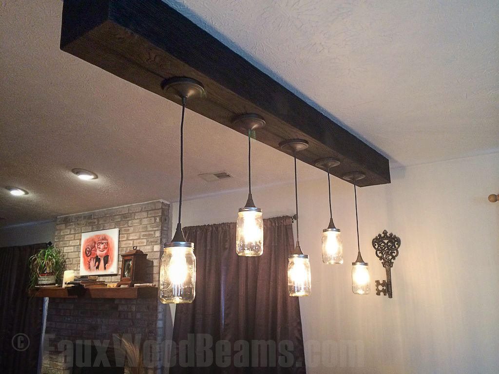 Vintage style bell jar lights hung from a heavy sandblasted ceiling hanging light fixtures faux wood workshop aloadofball Images