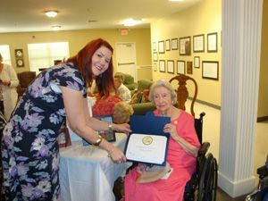 Shellie Zeigler, director of Blind & Physically Handicapped Library Services for the Mississippi Library Commission, presents Thelma Garner with her membership certificate.    Thelma Garner celebrated her one-hundredth birthday on April 5, 2011, with friends, family, guests, and staff from the Mississippi Library Commission. She was inducted into the 10-Squared Talking-Book Club and given a key to the City of Grenada by Mayor Billy F. Collins.