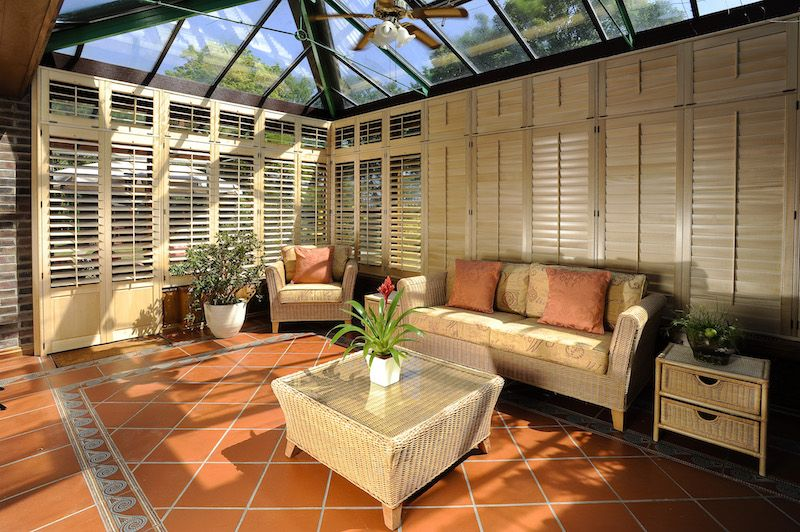 Beautiful wooden shutters fitted to a conservatory