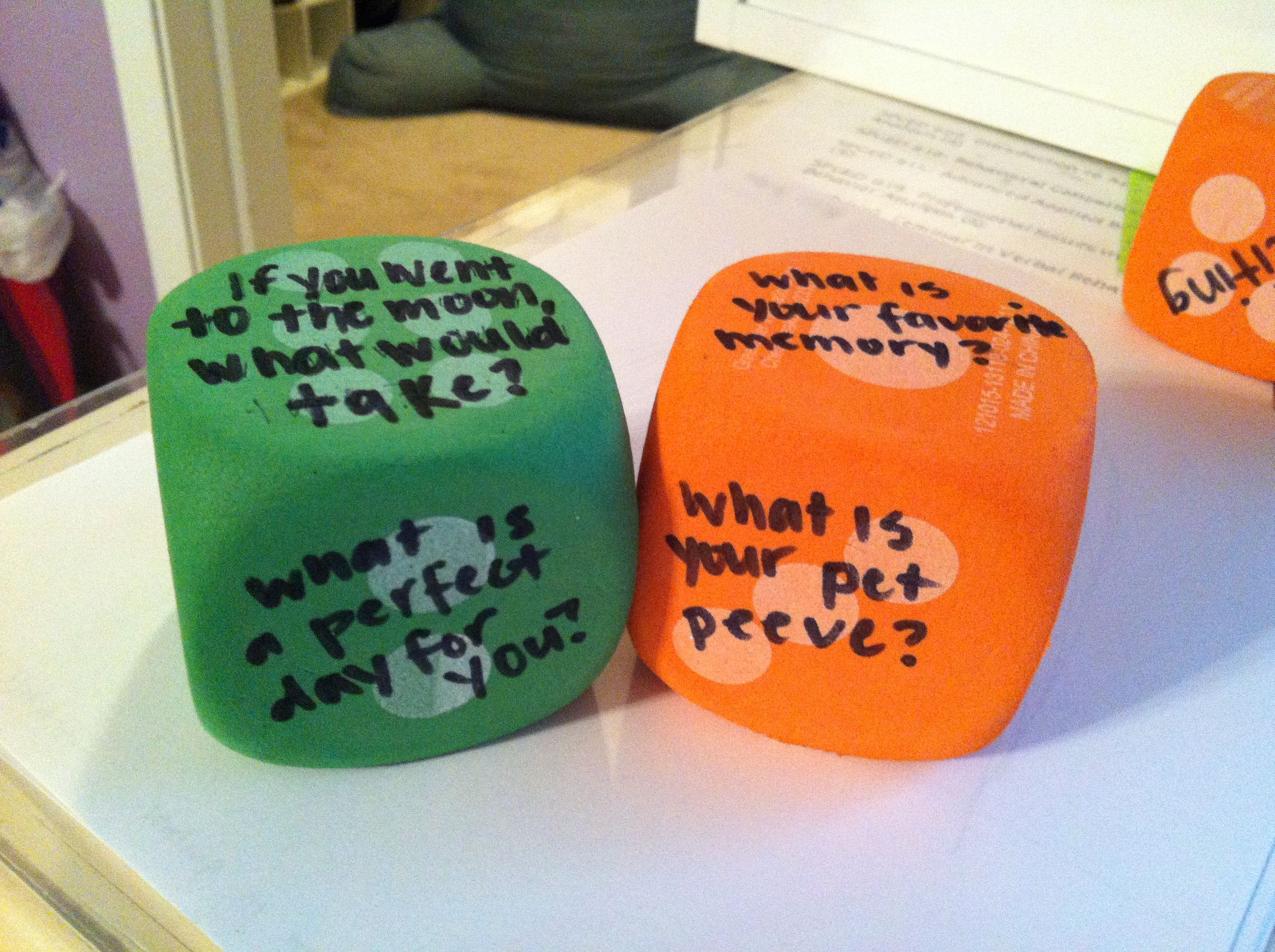 Foam dice from the dollar store. Getting to know you questions.