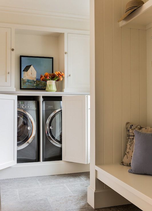 Country Laundry Room Features A Concealed Washer And Dryer Hidden