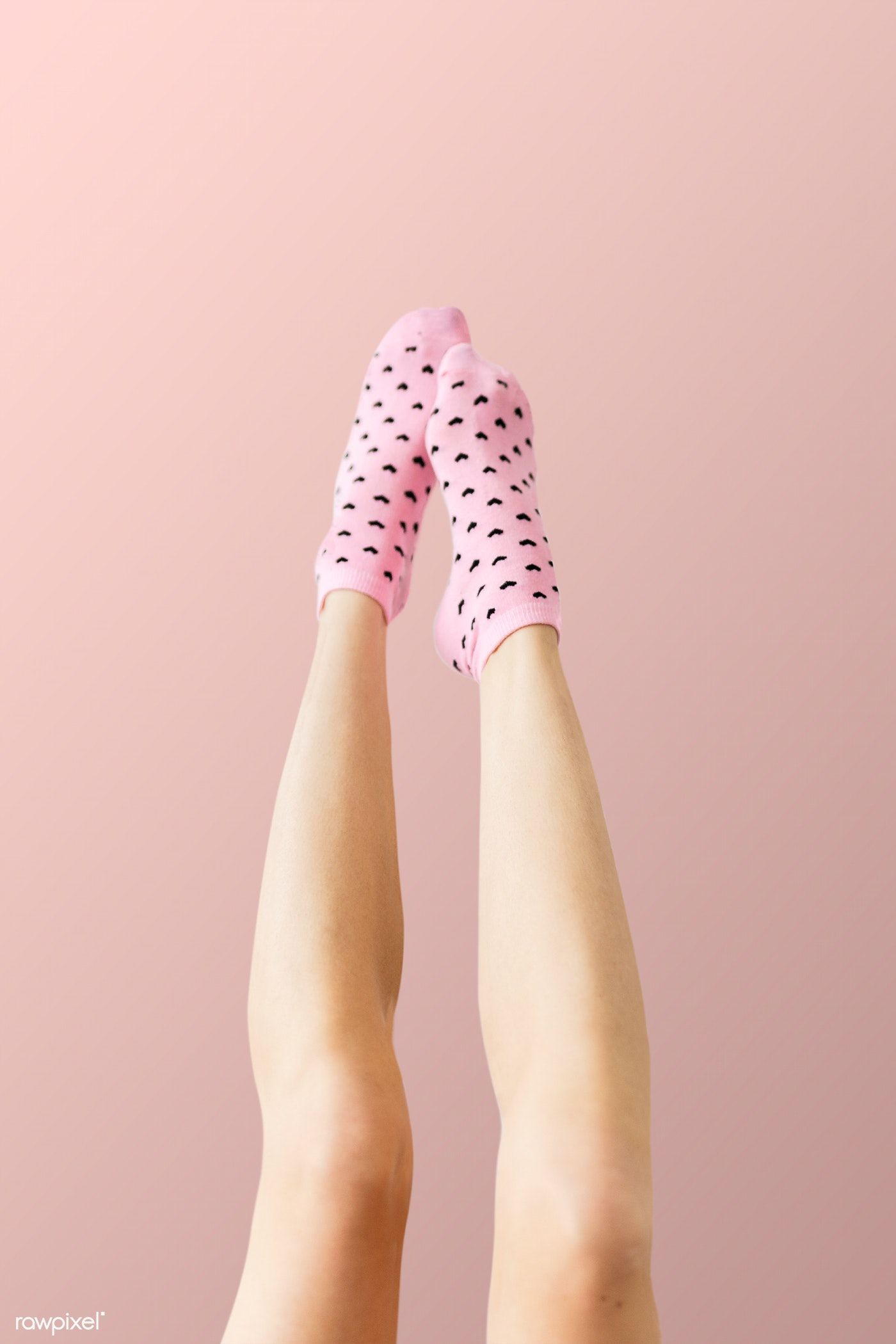 Woman Wearing Pink Socks Against A Pink Background Free Image By