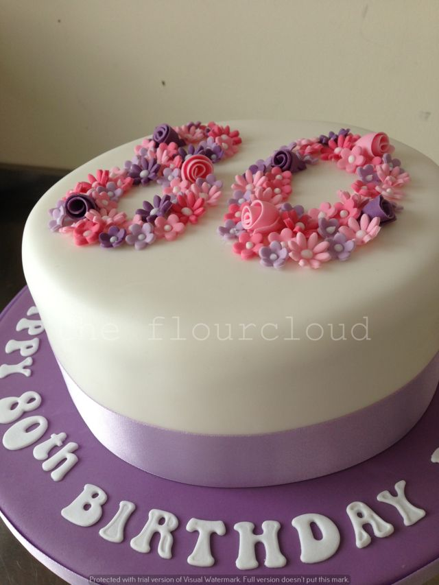 Delicate pink and purple flowers for this 80th birthday cake