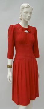 FC0485 Dress, red crepe with brass bullet shaped studs on yoke and neckline, American, early 1940s