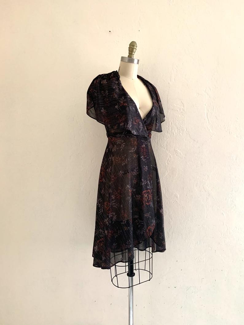 Vintage 70 S Floral Metallic Wrap Dress Etsy Wrap Dress Dresses Black Stripes Tops [ 1059 x 794 Pixel ]
