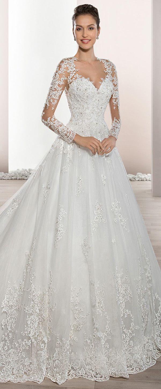 Junoesque tulle sheer jewel neckline aline wedding dress with
