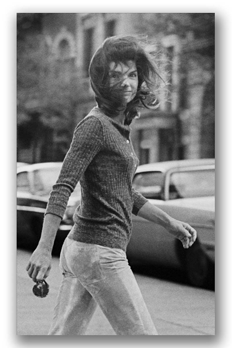 "My favorite Jackie image: ""I call it my Mona Lisa,"" Gallela said. This arresting photo was taken on Madison Avenue in New York City in 1971: Galella jumped into a taxi to follow Onassis, taking the shot when she looked around as the driver honked his horn. ""I don't think she knew it was me,"" ventured Galella. ""That's why she smiled a little."""