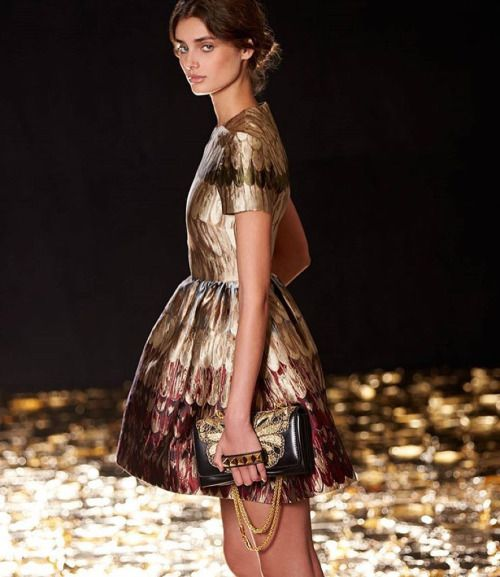 Starting Monday with an angel feathered dress from #FallWinter15 modeled by @taylor_hill for @neimanmarcus Fall book. #butterfly #vavavoom #golden by maisonvalentino http://ift.tt/1RjtVvJ