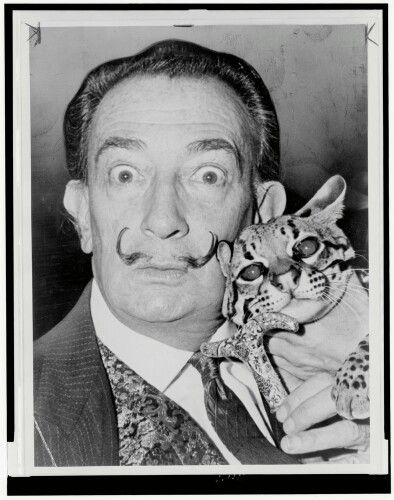 Salvador Dali and his cat. How awesome is his cat!