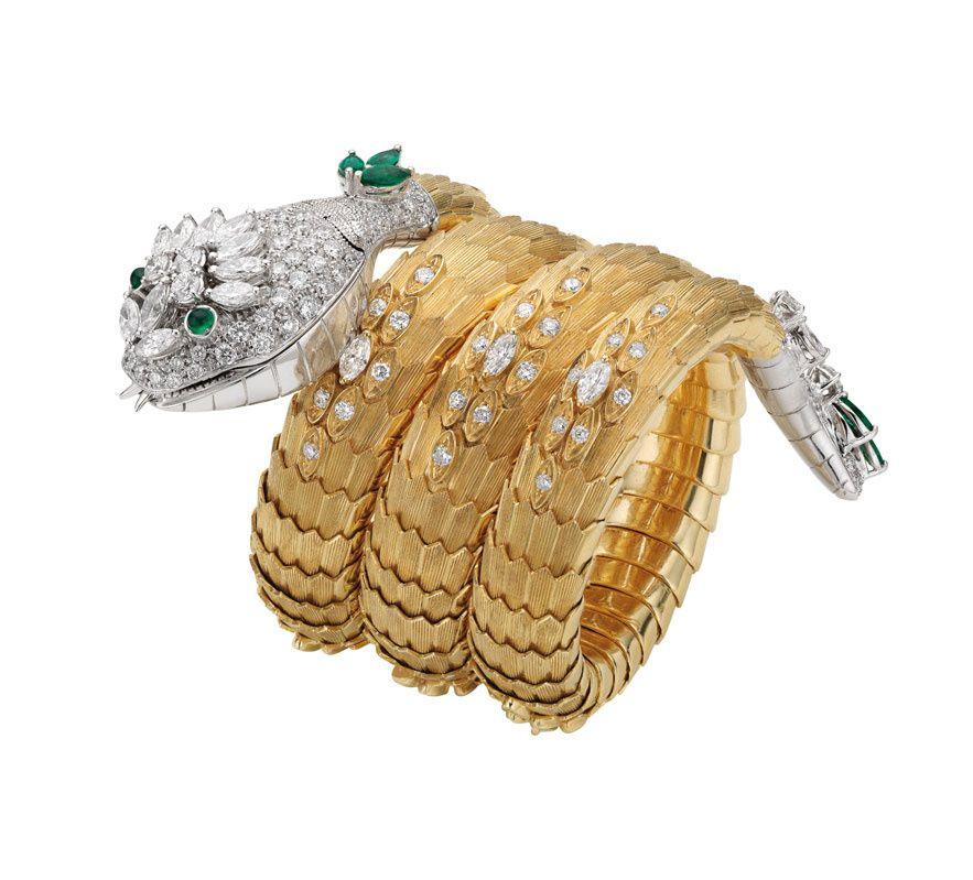 Serpenti pulsera / reloj de oro amarillo y platino, engastado con esmeraldas y diamantes, circa 1967.