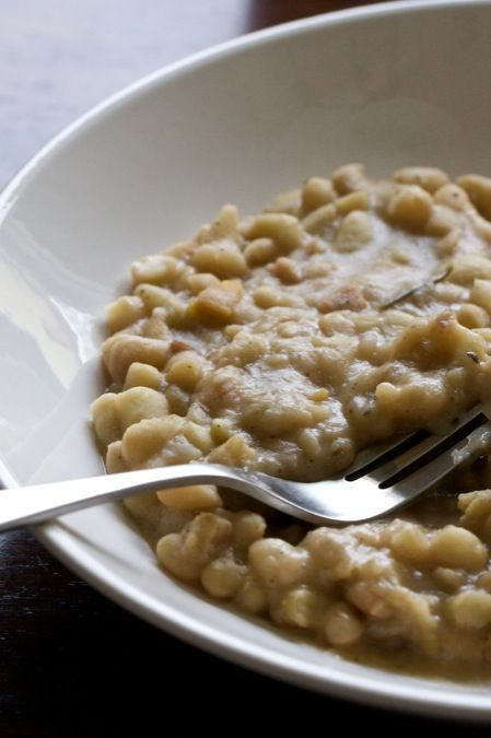 braised white beans, good alone, over rice, or as a bean dip.  Rosemary and white wine make it fantastic!