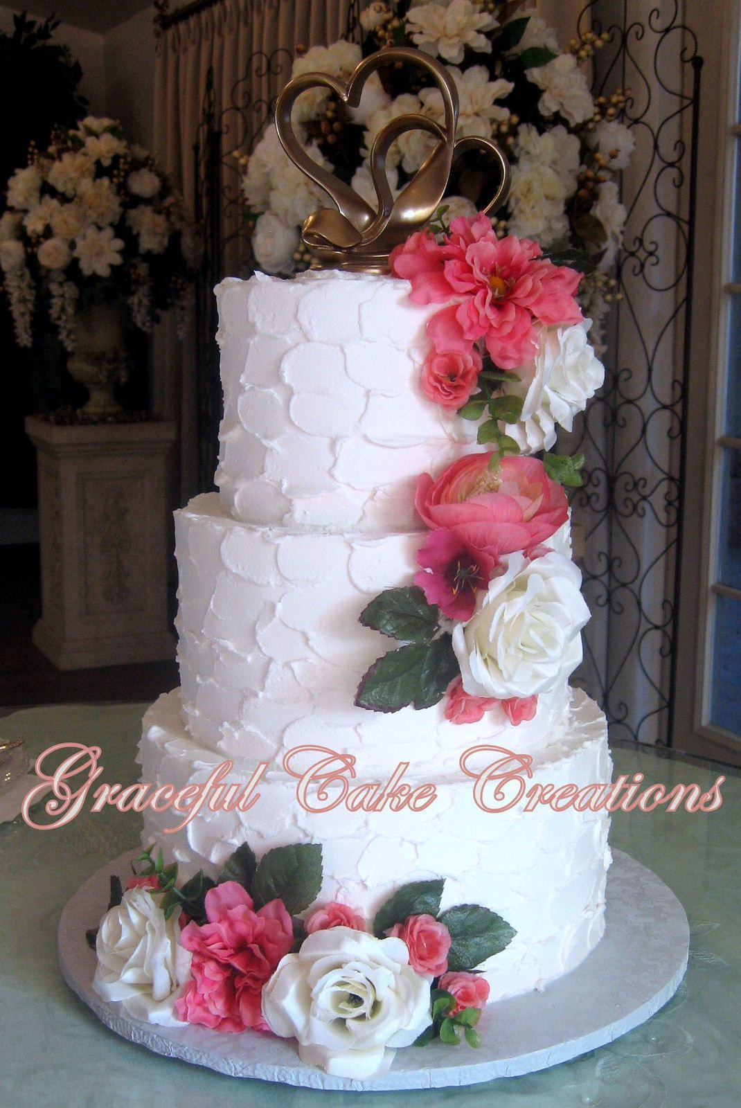 Textured White Butter Cream Wedding Cake With Pink And White Silk