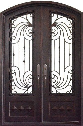 Hand forged wrought iron double entry doors with iron grilles. Makes ...