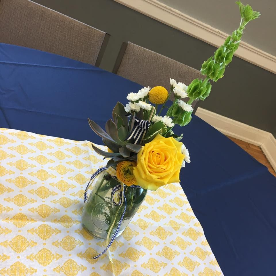 Blue and yellow centerpieces done for a twin graduation party theme
