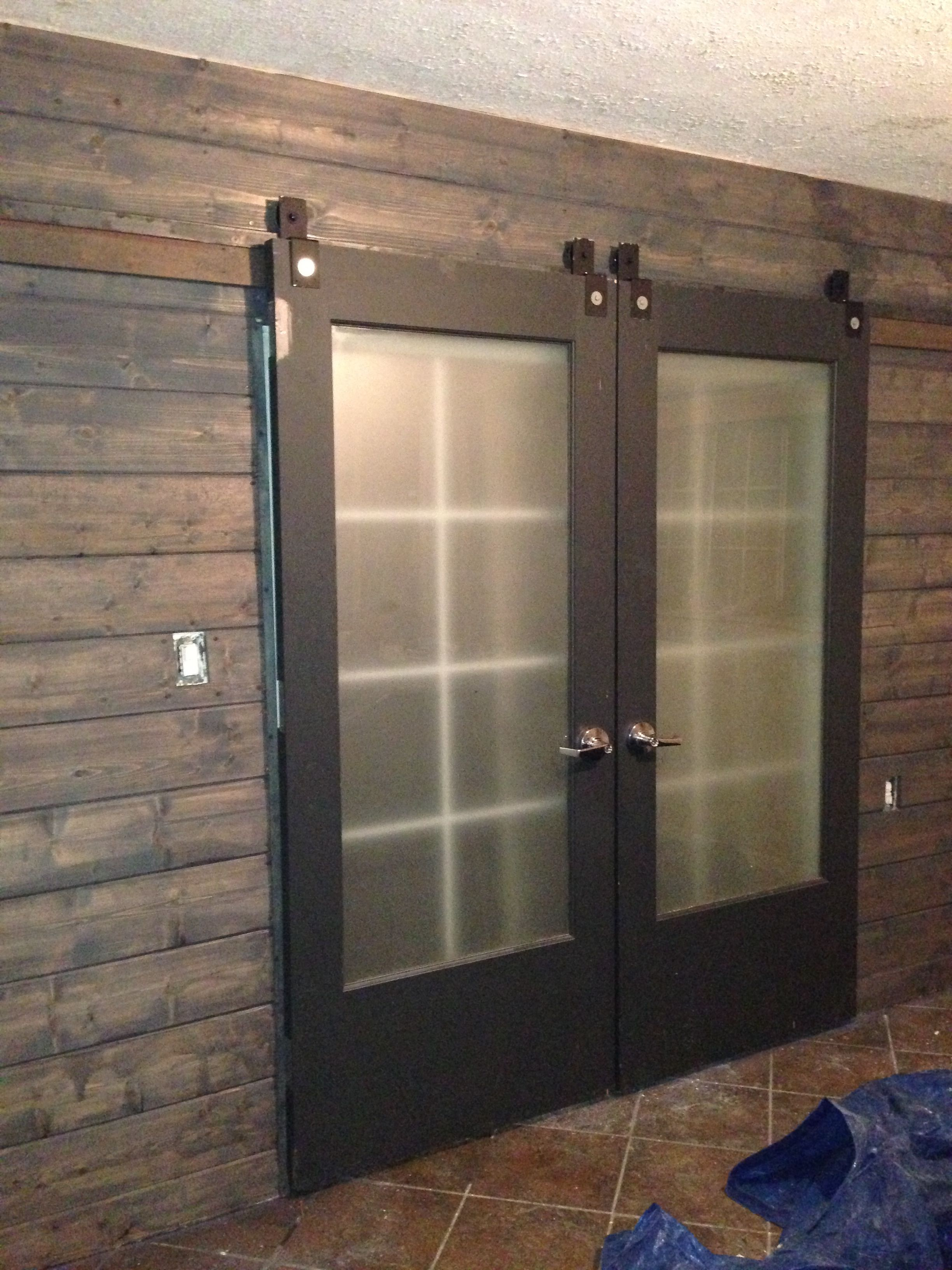 Sliding barn doors used to cover a sliding glass door ...