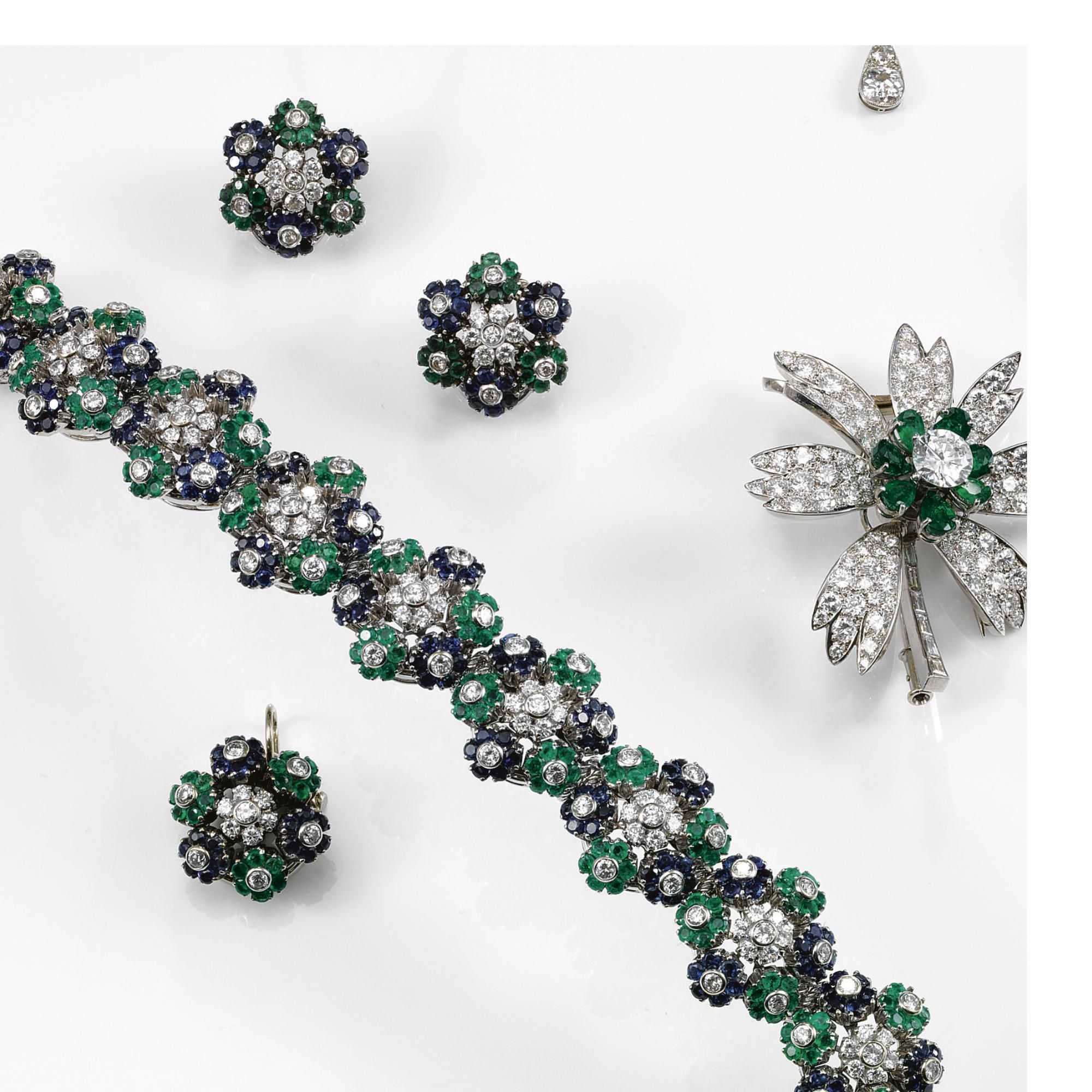 A sapphire emerald and diamond set the bracelet the ear clips and