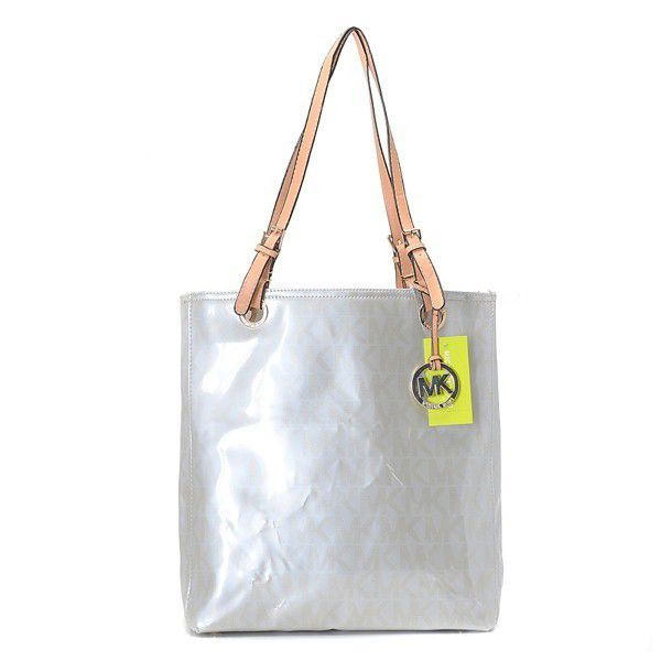 Want it. It can save 50% now on the site.Michael Kors Jet Set Logo Large  Silver Totes 3a76ff65bd