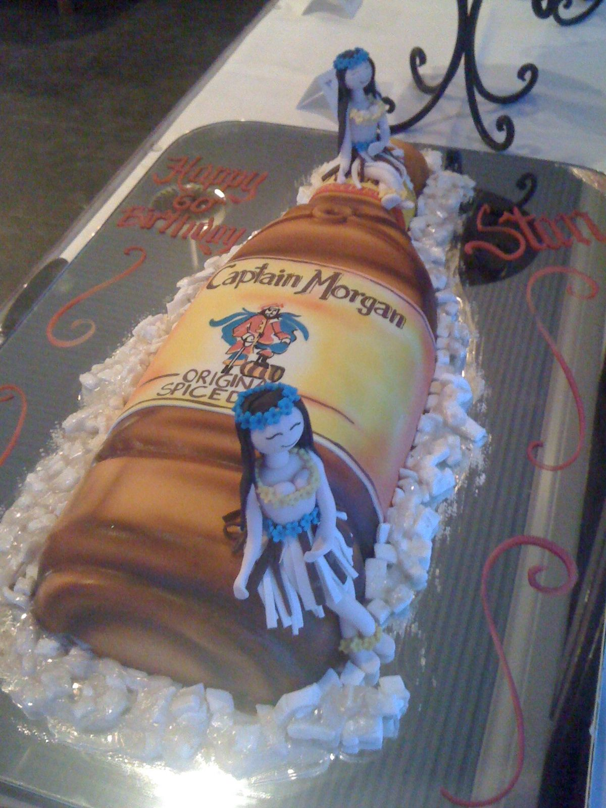 60th Birthday Cake Made By Sweet Art By Lucila In Miami Fl Captain Morgan Rum Bottle With Two Bodacious H 60th Birthday Cakes Boat Party Foods Rum Bottle