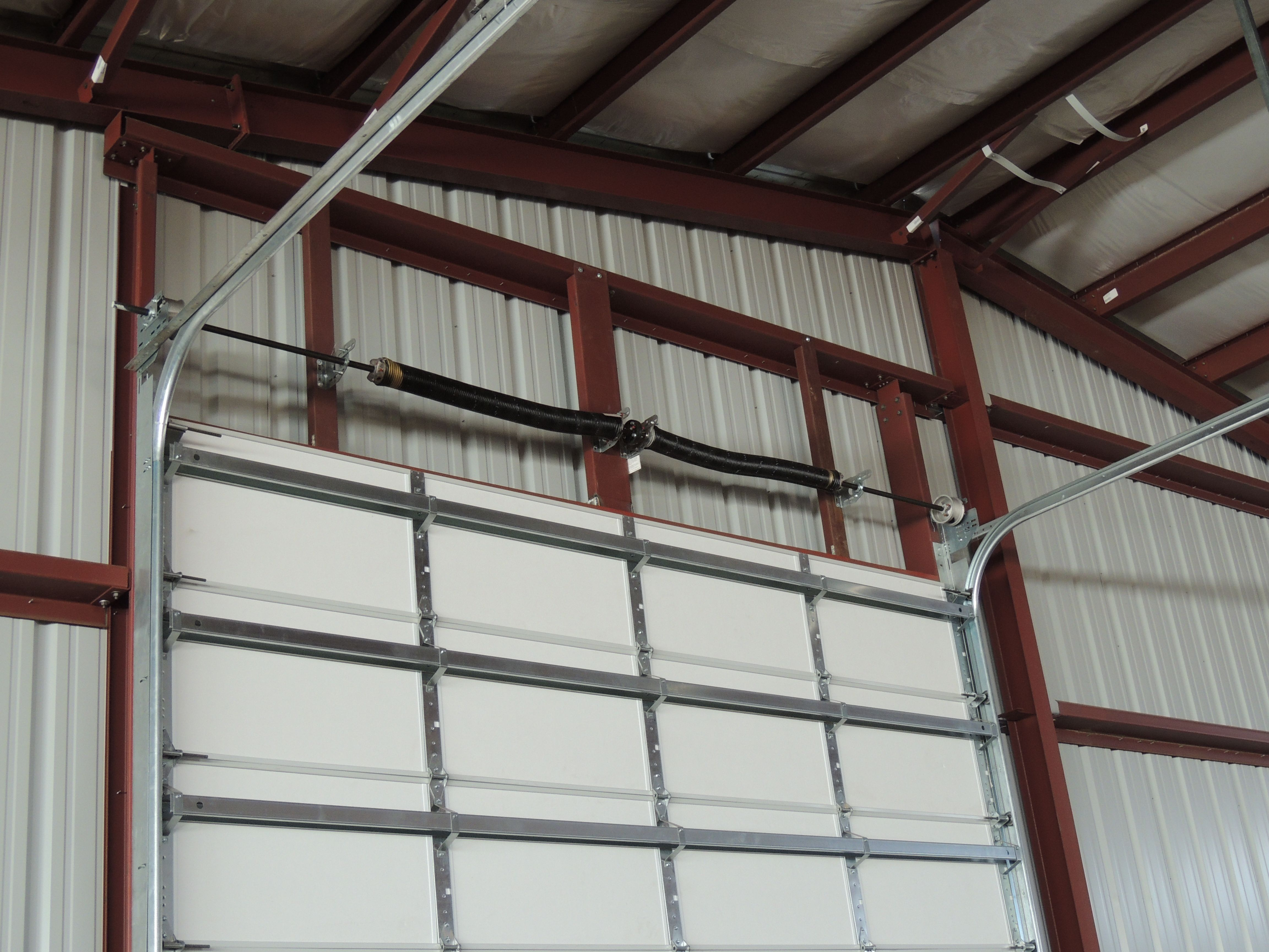 Overhead Garage Door Lift Options Call Metal Building Outlet At 1 800 486 8415 To Learn More About Over Metal Buildings Metal Garage Doors Metal Shop Building