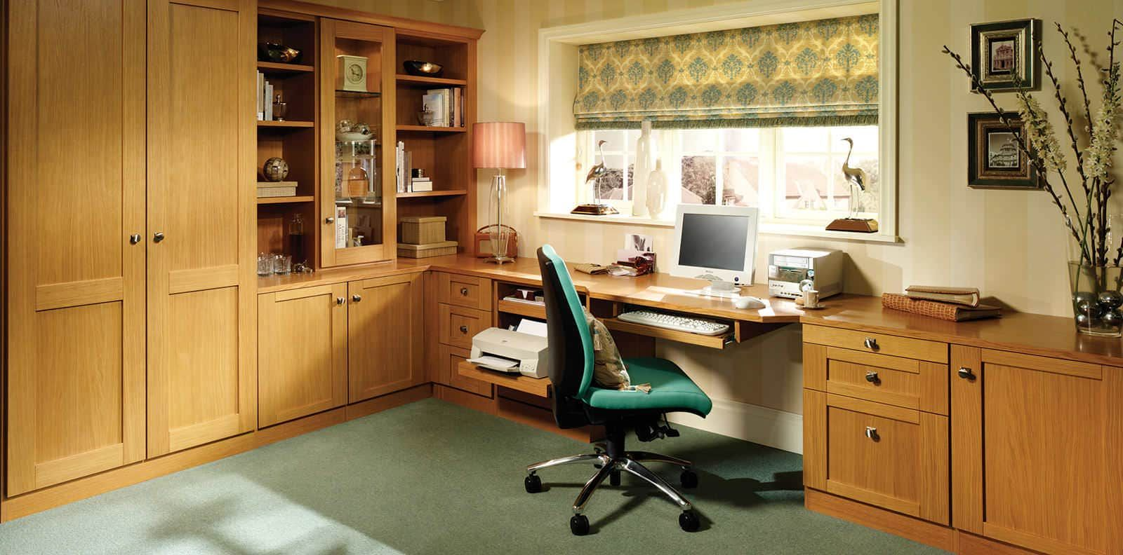Bespoke oak fitted home office with glass display shelving
