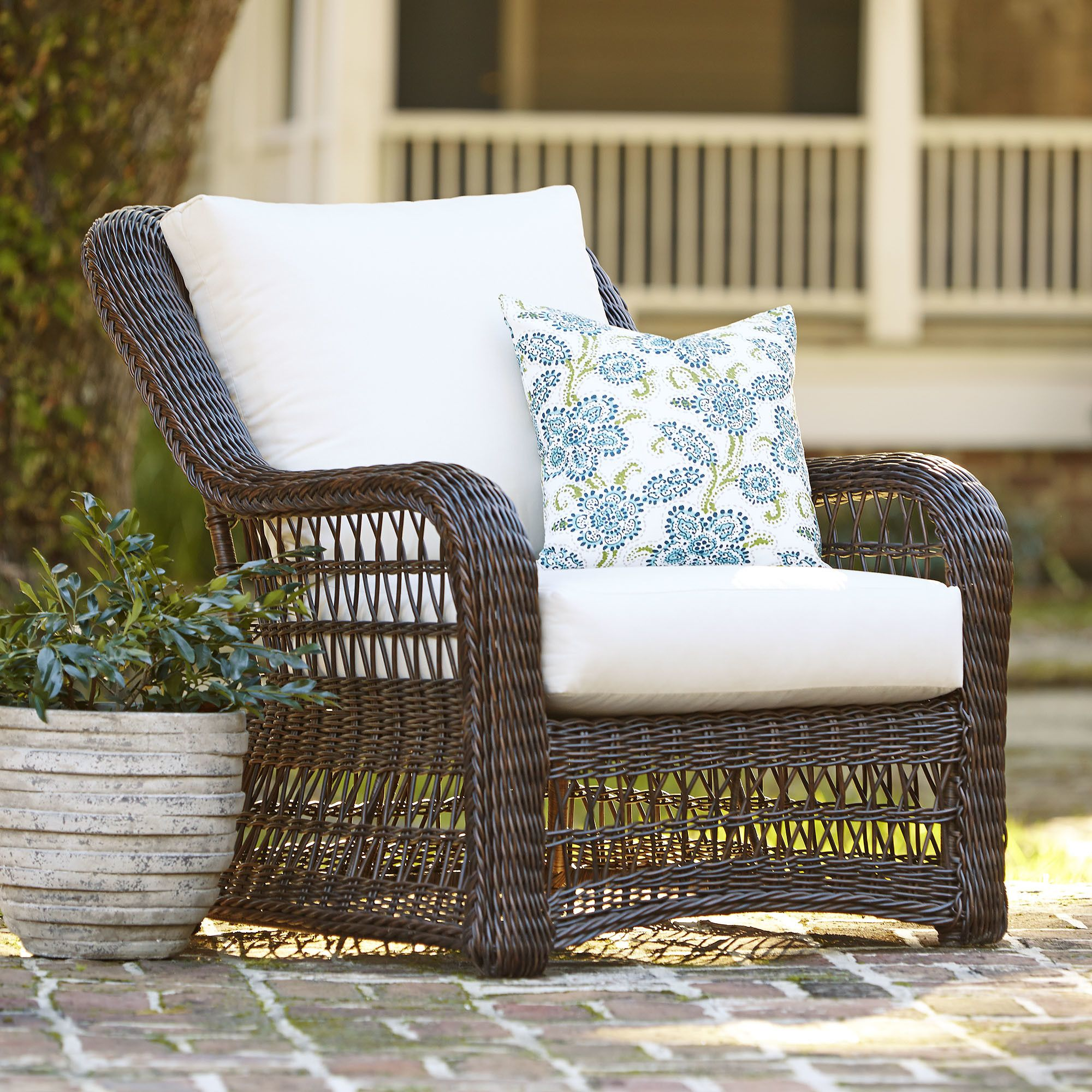 Rosemead wicker chair with sunbrella cushions with updated wicker styling for breezy island appeal the rosemead chair features smooth rounded arms and