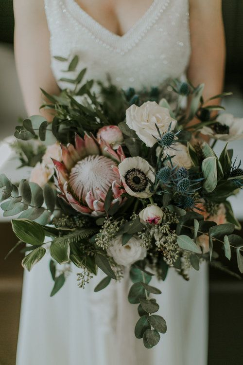 Protea Bouquet By Designs By Ahn Coordination By Polka Dot Events Amber Gress Photography Flower Bouquet Wedding Thistle Bouquet Wedding Blue Wedding Bouquet