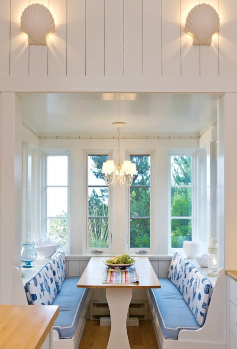 blue and white coastal cottage with seashell motif, stripes and
