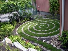 Grass and stone spiral - great idea for a small garden.