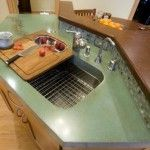 recycled glass backsplash and concrete countertop