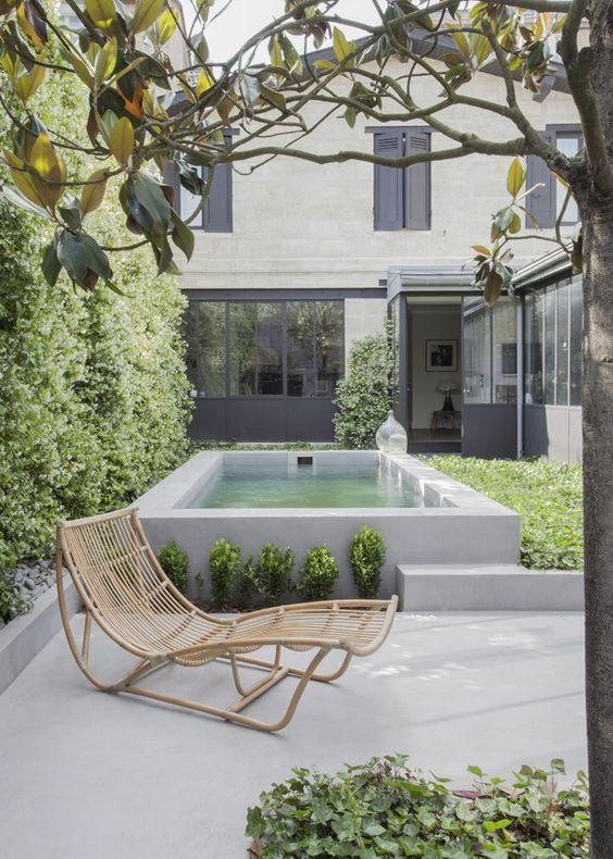 Raised pool in simple backyard