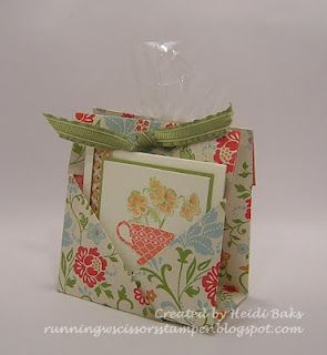 Love this!  Holds a tea bag on one side, a note card on the other and cookies in the center.