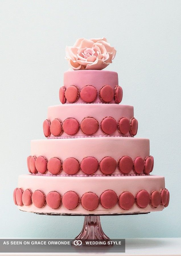 Pink ombré fondant icing adorned with #rose flavored #macarons and topped with a large sugar rose. #graceormonde #weddingstyle #GOWS #weddingcake #dessert #couture #bride #weddinginspiration #luxuryweddings