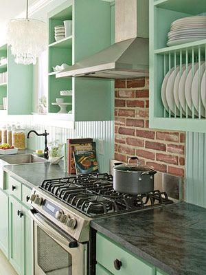 i like the brick backsplash with the mint color!
